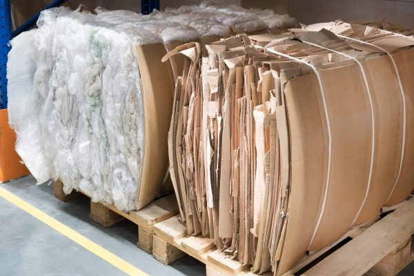 Pallets with wastepaper and wasteplastic packs