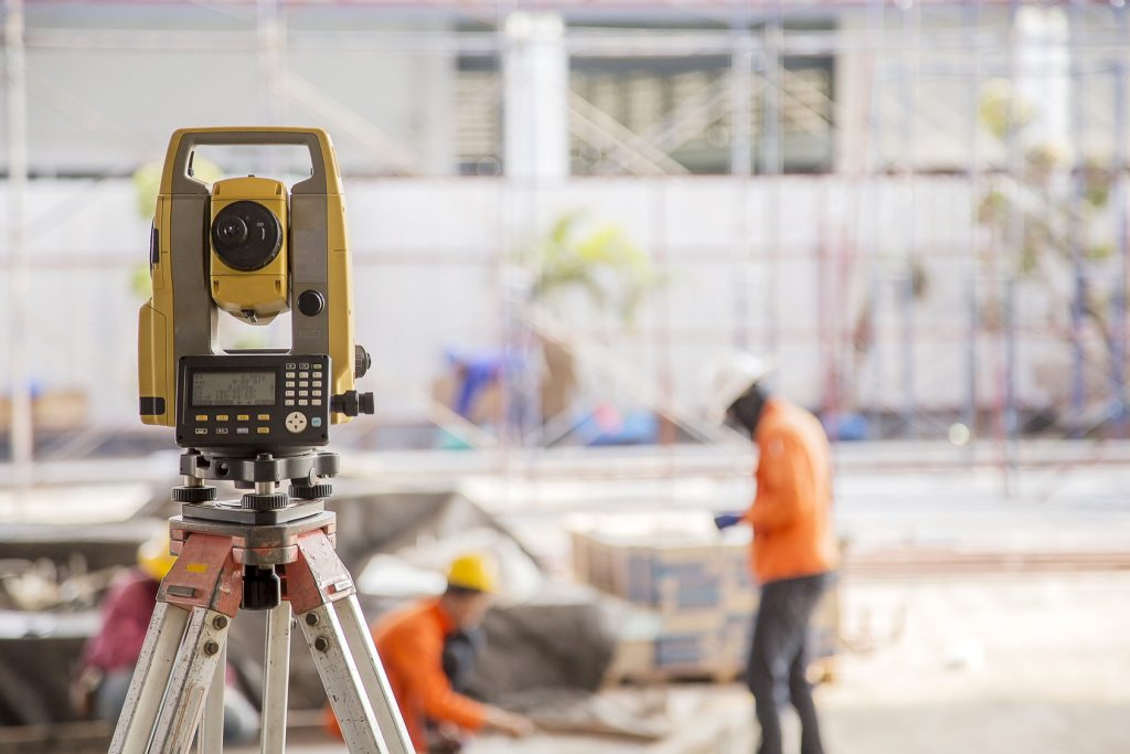 Surveyor equipment tacheometer or theodolite outdoors at constru
